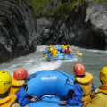 Tourists enjoying a thrilling rafting ride on the Otago Shotover River.