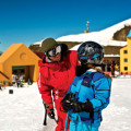 Two skiers exploring Cardrona Alpine Resort near Queenstown.