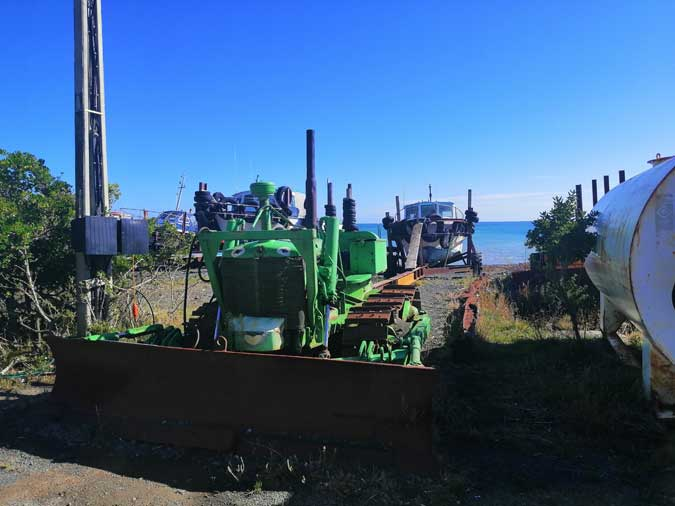 bulldozers ready to haul out fishing boats at Ngawi