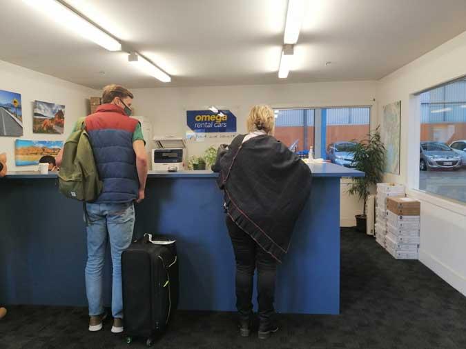 Two people inside rental car office