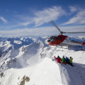 Tourists enjoying a helicopter scenic snow tour in the Christchurch Southern Alps.