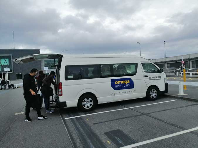 Loading luggage into Omega shuttle van at Wellington Airport