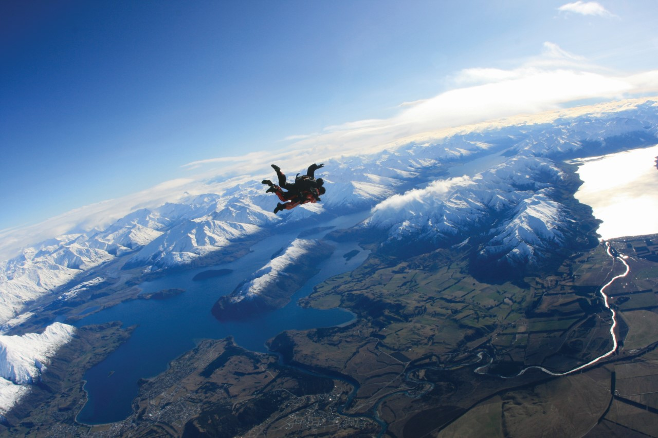 A skydiver taking in breathtaking views over Wanaka
